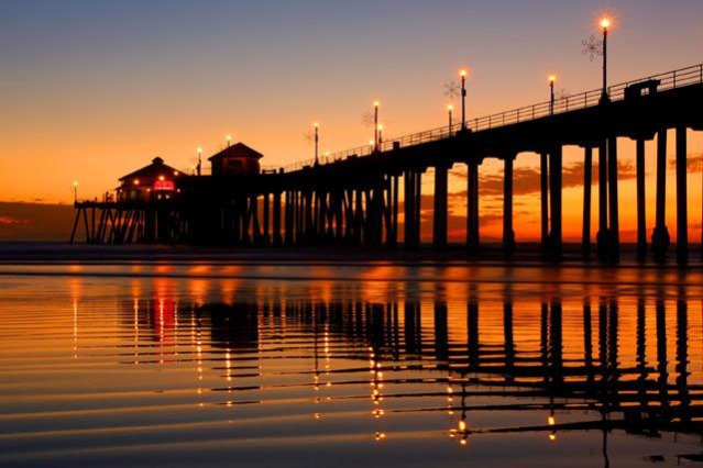"Huntington Beach's iconic pier in ""Surf City."""