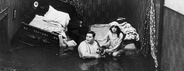"Fatty Artbuckle and Mabel Normand in the 1916 film ""Fatty Adrift."""