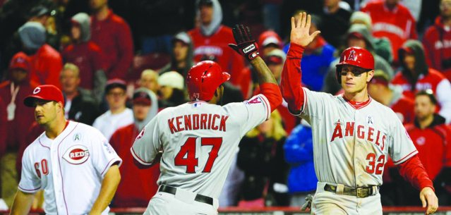 Josh Hamilton and Howie Kendrick celebrate after an Angels' win.