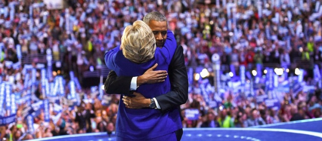 HILLARY CLINTON gets a hug from President Barack Obama Wednesday night at the Democratic National Convention (Clinton campaign photo).