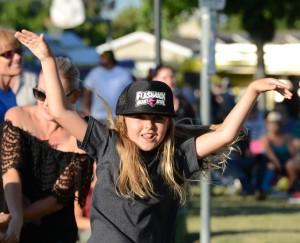 A YOUNG FAN dances at Thursday's concert in Eastgate Park (OC Tribune photo).