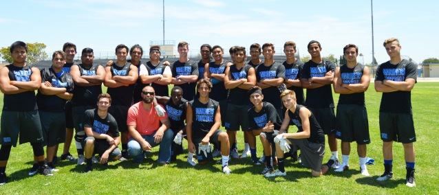 JON DORENBOS (in red shirt) with members of the Pacifica High football team (GGUSD photo).
