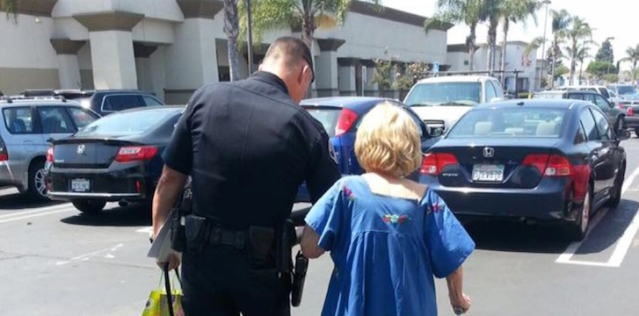 WPD OFFICER Matt Edinger escorts elderly lady who was the victim of fraud (WPD photo).