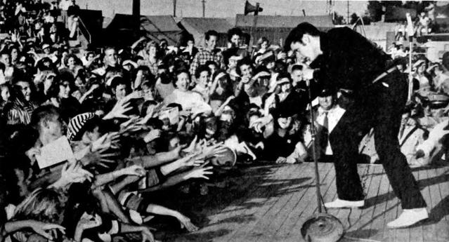 ELVIS PRESLEY performing live in 1956 (Wikipedia photo).