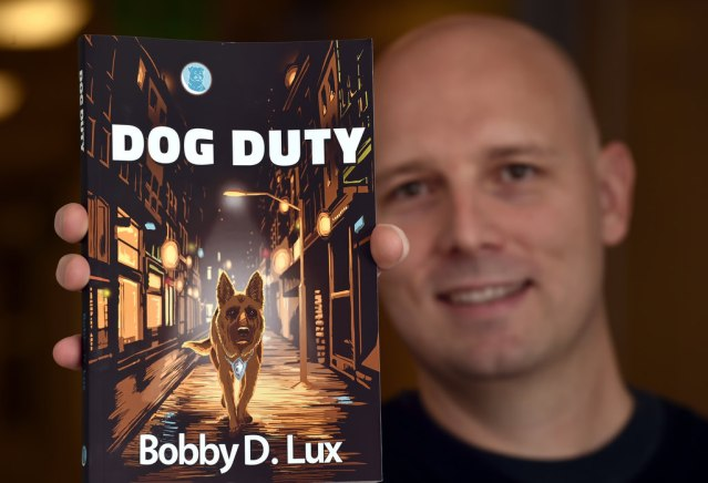 """BOBBY LUX, who wrote the book """"Dog Duty,"""" works at Garden Grove PD as a police dispatcher. (Photo by Steven Georges/Behind the Badge OC)."""