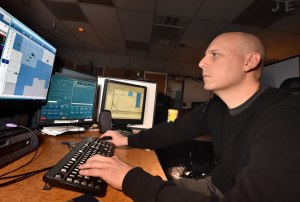 Bobby Lux, as a police dispatcher. (Behind the Badge OC)