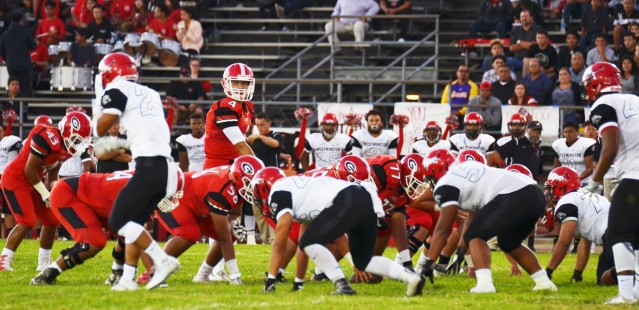 GARDEN GROVE (in red) defeated Westminster 28-21 in a pre-league game Friday on the Argo field (OC Tribune photo).