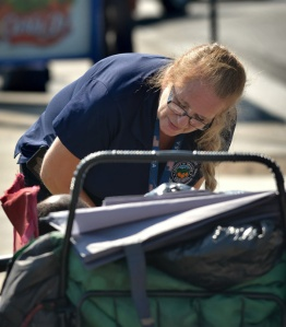 PEG PETERSON talks to a homeless man on Garden Grove Boulevard. )Photo by Steven Georges/Behind the Badge OC)