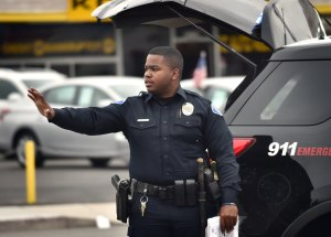 GGPD Officer R. Lee directs traffic safely around the screen of an automobile accident. (Photo by Steven Georges/Behind the Badge OC)