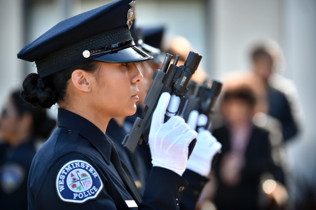 WESTMINSTER PD Recruit Frani Echavarri stands with her classmates for inspection before Golden West College Criminal Justice graduation ceremonies at Orange Coast College. )Photo by Steven Georges/Behind the Badge OC)