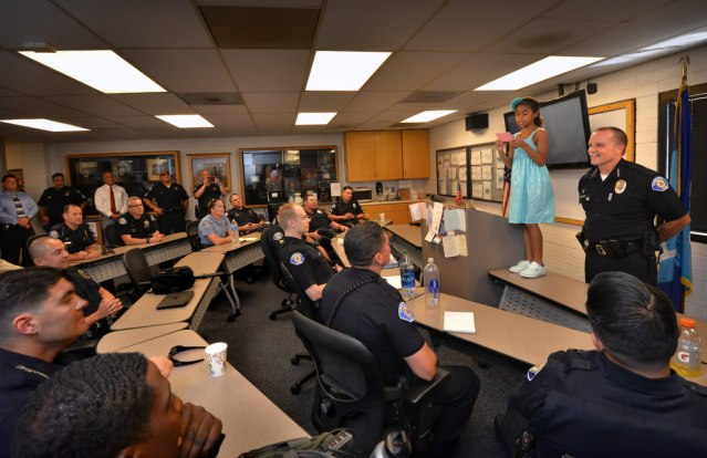 GARDEN GROVE Police Chief Todd Elgin (right) introduces Alyssa Castille to officers and members of the professional staff at the 2 p.m. shift briefing on Tuesday, Aug. 30. Photo by Steven Georges/Behind the Badge OC