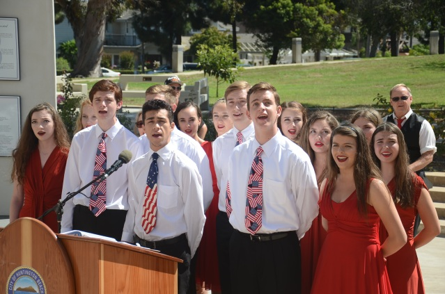 """SINGERS from the Academy for Performing Arts at Huntington Beach High sang """"The Star Spangled Banner"""" and """"God Bless America"""" at the 9/11 memorial event Sunday in Huntington Beach (OC Tribune photo)."""