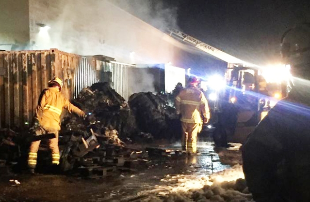 TRASH and wooden pallets burned behind a Walmart store in Westminster Friday night (WPD photo).