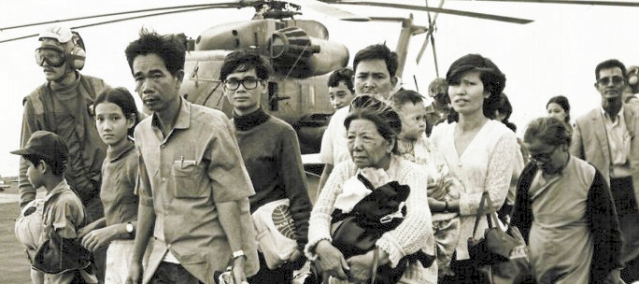 "VIETNAMESE refugees aboard a U.S. Navy ship in the evacuations during ""Black April."" (Wikipedia photo)."