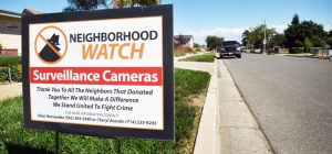 Signs on the street inform visitors of the Westminster neighborhood that surveillance cameras have been installed to keep neighbors who live there safe. Photo by Steven Georges/Behind the Badge OC