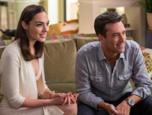 "GAL GADOT and Jon Hamm star in ""Keeping Up With the Jones."""