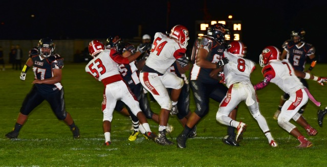 GARDEN GROVE and Los Amigos clashed Thursday night in the Garden Grove League football opener for both teams (OC Tribune photo).
