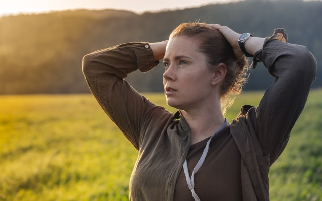 "AMY ADAMS stars in ""Arrival,"" a sci-fi film about mysterious aliens who suddenly appear in the sky."