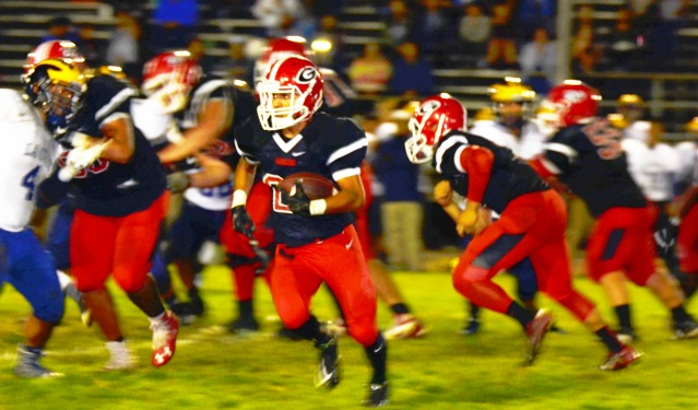 GARDEN GROVE HIGH ran past La Quinta 47-28 Thursday night to win a fifth straight Garden Grove League varsity football title (OC Tribune photo).