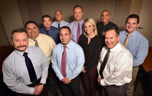 Garden Grove PD Crimes Against Persons Unit includes from left, Lt. Bob Bogue, Det. Dave Lopez, Det. Joe Kolano, Det. John Casaccia, Det. Luis Payan, Det. Steve Heine, Det. Lea Kovacs., Det. Pete Garcia, Det. Mike Farley and Det. Ed DesBiens. (Photo by Steven Georges/Behind the Badge OC)
