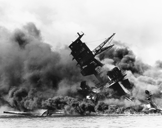 THE U.S.S. Arizona in flames and sinking after being attacked on Dec. 7, 1941 (U.S. Navy photo).