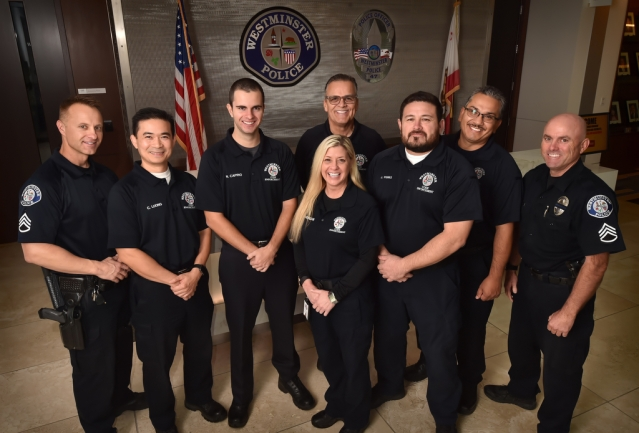 Westminster PD's code enforcement team. From left is Sgt. Don Webb, Officer Chi Luong, assistant Noah Caprio, Code Enforcement Manager Vicki Morgan, Officer Jaime Rosas, Officer Jorge Perez, Officer Rene Ramirez and Sgt. Jim Kingsmill. Photo by Steven Georges/Behind the Badge OC