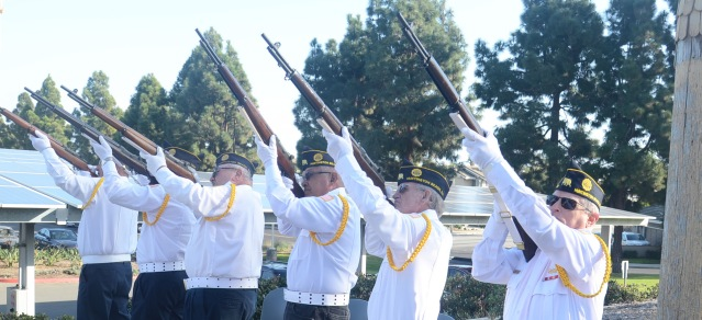 THE HONOR GUARD gave a gun-salute at the observance Wednesday of Pearl Harbor Day in Huntington Beach (OC Tribune photo).
