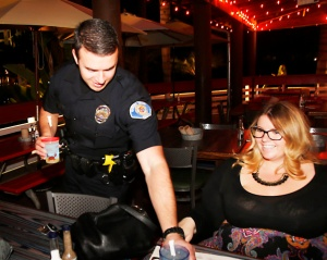 Garden Grove Officer Jeremy Morse waits tables at Joe's Crab Shack. Photo by Christine Cotter