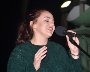 "KAYLA WENDT, winner of the 2016 ""Voice of Garden Grove"" contest, sang at the tree-lighting event (OC Tribune photo)."