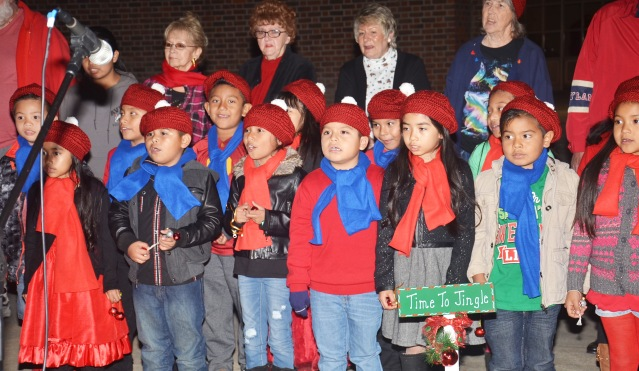 PROJECT SHUE singers perform at the Tree-Lighting and Community Song at the Westminster Civic Center Monday night (OC Tribune photo).