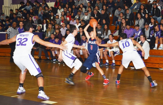 SANTIAGO'S DEFENSE (in white) served the Cavaliers well in a 49-44 victory Wednesday night at SHS gym (OC Tribune photo).