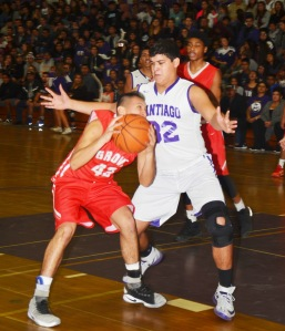 ADRIAN MONTES (32) is a tall order on defense for Santiago in its win Friday against Garden Grove (OC Tribune photo).