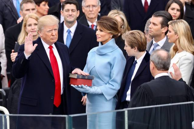 PRESIDENT DONALD TRUMP, sworn in on Friday, began taking action Monday with executive orders on free trade and abortion.