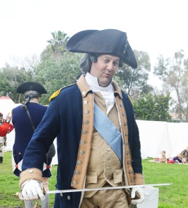 GEORGE WASHINGTON (David Grace) draws his sword (OC Tribune photo).