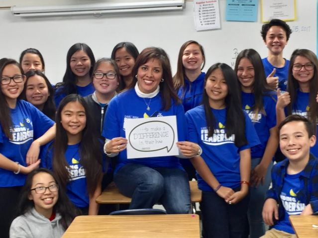ALAMITOS Intermediate School teacher Monique Becerra takes a class photo to show that she teaches to make a difference in the lives of her students.