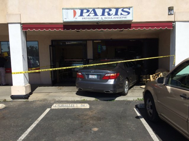 A LEXUS sedan drove into a bakery in Westminster on Wednesday morning. Three  people were injured, one of them critically (OCFA photo).